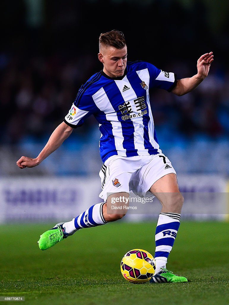 Alfred Finnbogason of Real Sociedad runs with the ball during the La Liga match between Real Socided and Elche FC at Estadio Anoeta on November 28, 2014 in San Sebastian, Spain.