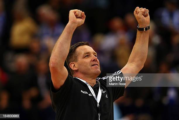 Alfred Gislason head coach of Kiel celebrates after winning the DKB Handball Bundesliga match between HSV Hamburg and THW Kiel at the O2 World on...