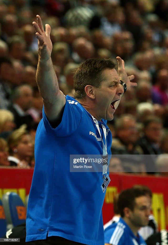 <a gi-track='captionPersonalityLinkClicked' href=/galleries/search?phrase=Alfred+Gislason&family=editorial&specificpeople=2115165 ng-click='$event.stopPropagation()'>Alfred Gislason</a>, head coach of Kiel celebrates during the DKB Handball Bundesliga match between THW Kiel and SG Flensburg-Handewitt at Sparkassen Arena on November 7, 2012 in Kiel, Germany.