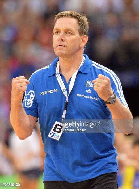 Alfred Gislason head coach of Kiel celebrates his teams win during the DKB Handball Budesliga mtach between HSV Hamburg and THW Kiel at the O2 world...