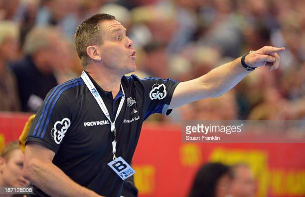 Alfred Gislason head coach of Kiel ponders during the Bundesliga handball match between THW Kiel and Rhein Neckar Loewen at the Sparkasse arena on...