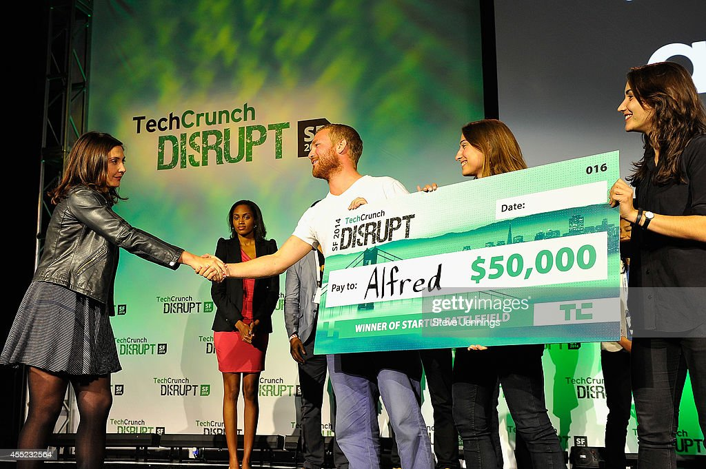 Alfred is awarded the Disrupts Cup at TechCrunch Disrupt at Pier 48 on September 10 2014 in San Francisco California