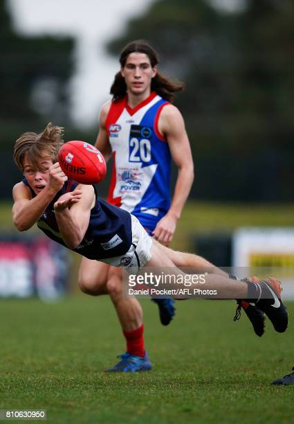 Alfred Jarnestrom of the Dragons handpasses the ball during the round 12 TAC Cup match between Gippsland and Sandringham at Casey Fields on July 8...