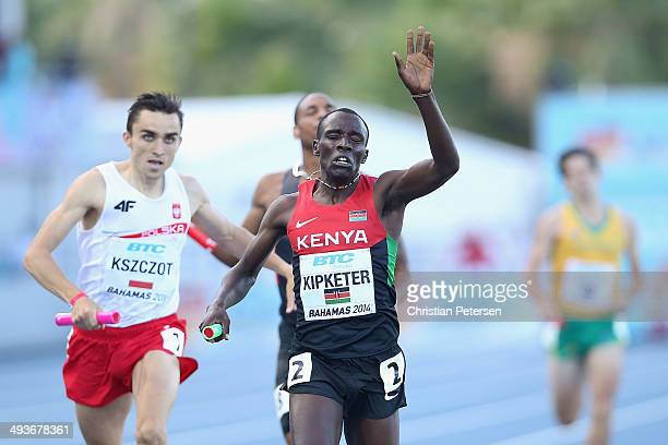 Alfred Kipketer of Kenya celebrates as he crosses the finish line ahead of Adam Kszczot of Poland to win the Mens 4x800 metres relay during day one...