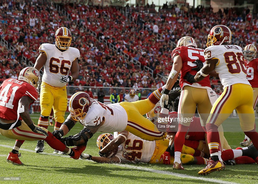 Alfred Morris #46 of the Washington Redskins scores a touchdown in the second quarter under the block of Shawn Lauvao #77 of the Washington Redskins against the San Francisco 49ers at Levi's Stadium on November 23, 2014 in Santa Clara, California.