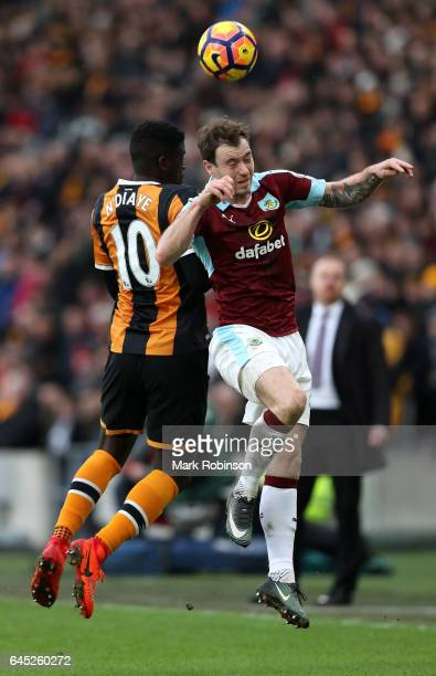Alfred N'Diaye of Hull City and Ashley Barnes of Burnley battle to win a header during the Premier League match between Hull City and Burnley at KCOM...