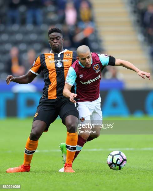 Alfred N'Diaye of Hull City and Sofiane Feghouli of West Ham United battle for possession during the Premier League match between Hull City and West...
