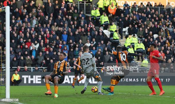 Alfred N'Diaye of Hull City scores the opening goal past Simon Mignolet of Liverpool during the Premier League match between Hull City and Liverpool...