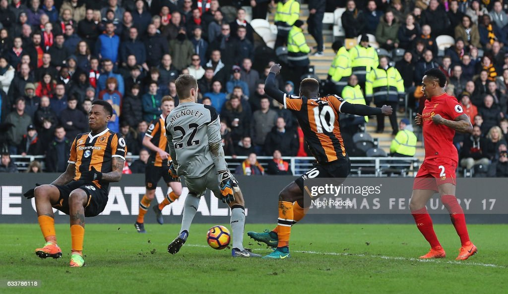 Alfred N'Diaye (2nd R) of Hull City scores the opening goal past Simon Mignolet (2nd L) of Liverpool during the Premier League match between Hull City and Liverpool at KCOM Stadium on February 4, 2017 in Hull, England.