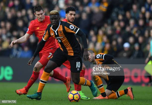 Alfred N'Diaye of Hull City takes the ball away from James Milner of Liverpool during the Premier League match between Hull City and Liverpool at...