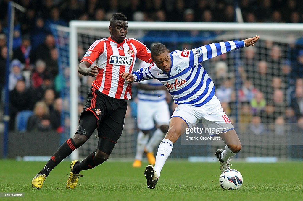 Alfred N'Diaye of Sunderland and Loic Remy of Queens Park Rangers battle for the ball during the Barclays Premier League match between Queens Park Rangers and Sunderland at Loftus Road on March 9, 2013 in London, England.