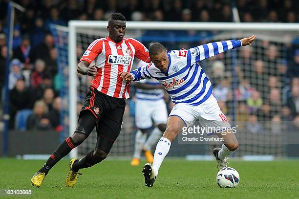 Alfred N'Diaye of Sunderland and Loic Remy of Queens Park Rangers battle for the ball during the Barclays Premier League match between Queens Park...
