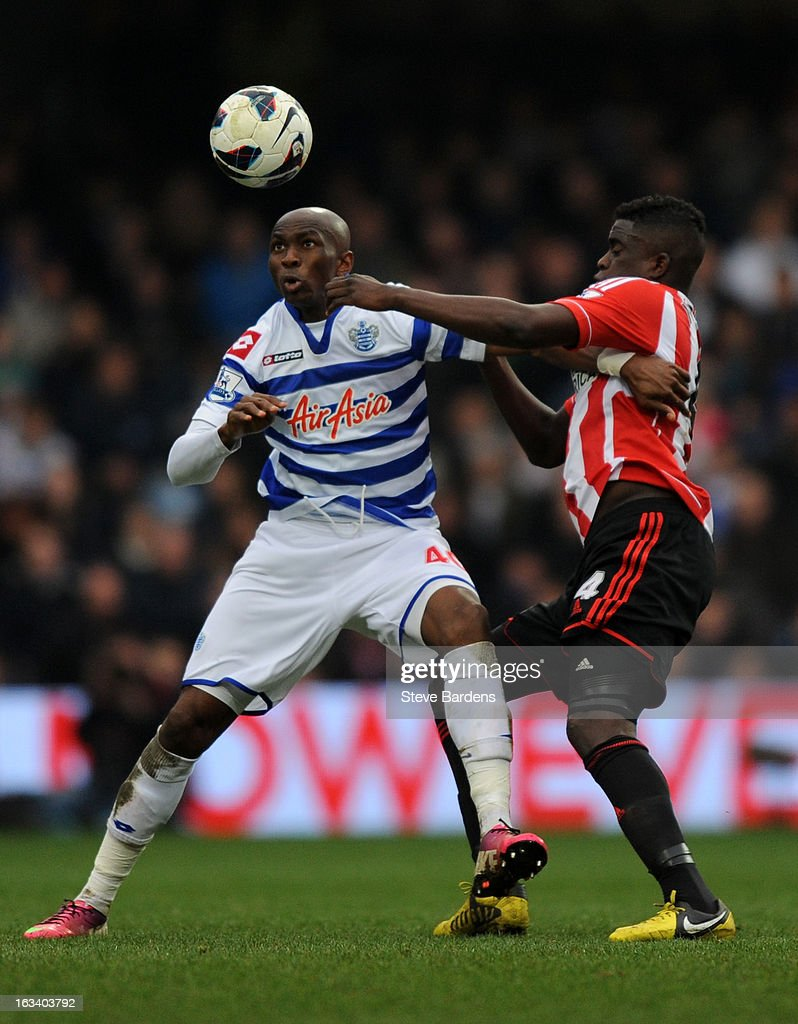 Alfred N'Diaye of Sunderland and Stephane Mbia of Queens Park Rangers battle for the ball during the Barclays Premier League match between Queens Park Rangers and Sunderland at Loftus Road on March 9, 2013 in London, England.
