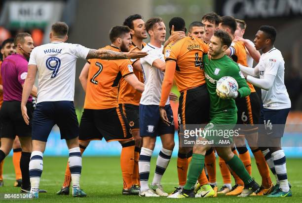 Alfred NDiaye of Wolverhampton Wanderers and Chris Maxwell of Preston North End grapple during the Sky Bet Championship match between Wolverhampton...