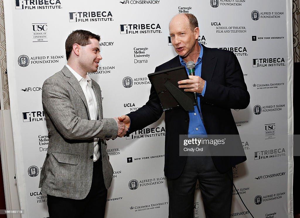 Alfred P. Sloan Foundation Director Doron Weber (R) presents the award to filmmaker Barnett Brettler during the Sloan Foundation Student Grand Jury Prize Award presentation on April 9, 2013 in New York City.