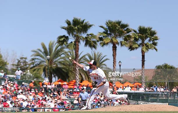 Alfredo Aceves of the Baltimore Orioles pitches during the eighth inning of the game against the Boston Red Sox at Ed Smith Stadium on March 11 2014...