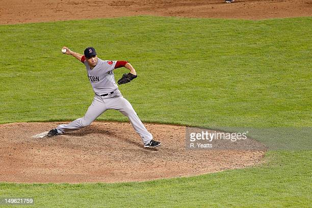 Alfredo Aceves of the Boston Red Sox delivers a pitch against the Texas Rangers at Rangers Ballpark in Arlington on July 24 2012 in Arlington Texas