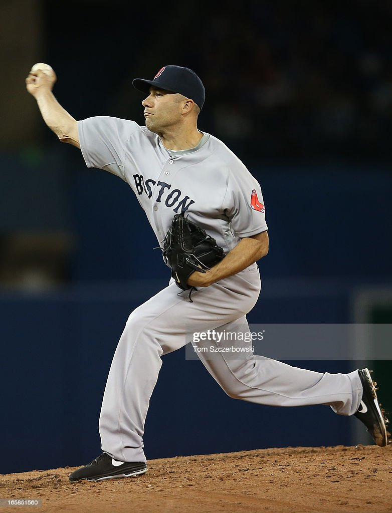 Alfredo Aceves #91 of the Boston Red Sox delivers a pitch during MLB game action against the Toronto Blue Jays on April 6, 2013 at Rogers Centre in Toronto, Ontario, Canada.