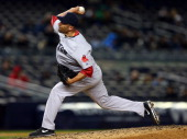 Alfredo Aceves of the Boston Red Sox delivers a pitch in the eighth inning against the New York Yankees on April 3 2013 at Yankee Stadium in the...