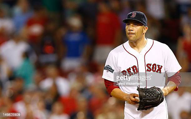Alfredo Aceves of the Boston Red Sox looks up at the scoreboard against the Minnesota Twins during the game on August 4 2012 at Fenway Park in Boston...
