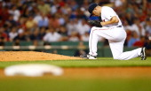 Alfredo Aceves of the Boston Red Sox performs a ritual before pitching against the Minnesota Twins during the game on August 2 2012 at Fenway Park in...
