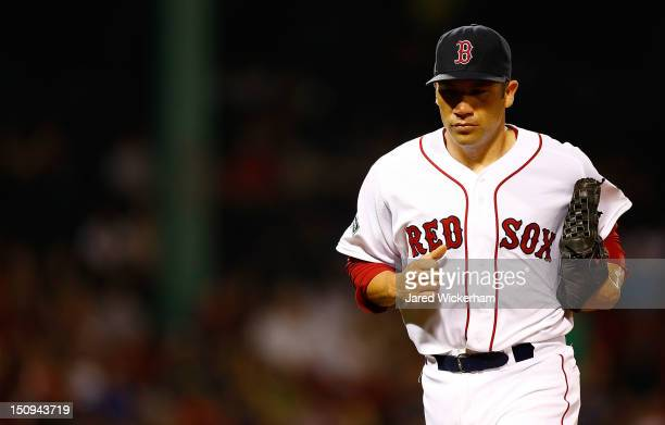 Alfredo Aceves of the Boston Red Sox pitches against the Los Angeles Angels of Anaheim during the game on August 23 2012 at Fenway Park in Boston...
