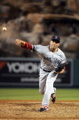 Alfredo Aceves of the Boston Red Sox pitches against the Los Angeles Angels of Anaheim at Angel Stadium of Anaheim on August 29 2012 in Anaheim...