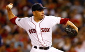 Alfredo Aceves of the Boston Red Sox pitches against the Minnesota Twins during the game on August 4 2012 at Fenway Park in Boston Massachusetts