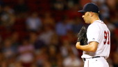Alfredo Aceves of the Boston Red Sox pitches against the Minnesota Twins during the game on August 2 2012 at Fenway Park in Boston Massachusetts