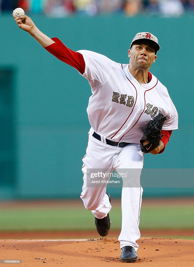 Alfredo Aceves #91 of the Boston Red Sox pitches against the Philadelphia Phillies during the interleague game on May 27, 2013 at Fenway Park in Boston, Massachusetts.