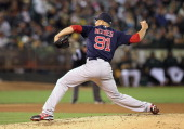 Alfredo Aceves of the Boston Red Sox pitches during a game against the Oakland Athletics at Oco Coliseum on August 31 2012 in Oakland California