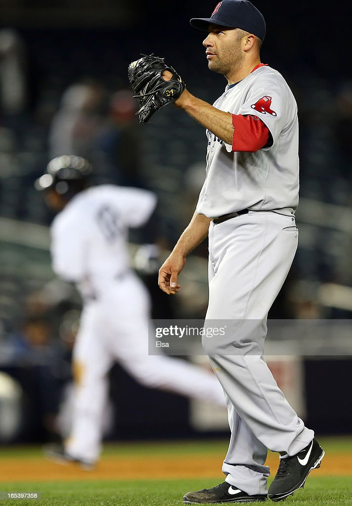 <a gi-track='captionPersonalityLinkClicked' href=/galleries/search?phrase=Alfredo+Aceves&family=editorial&specificpeople=5514493 ng-click='$event.stopPropagation()'>Alfredo Aceves</a> #91 of the Boston Red Sox reacts after giving up a three run home run in the eighth inning as <a gi-track='captionPersonalityLinkClicked' href=/galleries/search?phrase=Vernon+Wells&family=editorial&specificpeople=212943 ng-click='$event.stopPropagation()'>Vernon Wells</a> #12 of the New York Yankees rounds third base n April 3, 2013 at Yankee Stadium in the Bronx borough of New York City.