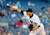 Alfredo Aceves of the New York Yankees in action against the Pittsburgh Pirates at Yankee Stadium on May 18 2014 in the Bronx borough of New York...