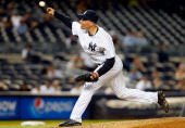 Alfredo Aceves of the New York Yankees in action against the Seattle Mariners at Yankee Stadium on June 2 2014 in the Bronx borough of New York City...
