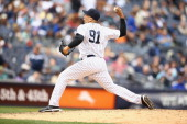 Alfredo Aceves of the New York Yankees in action against the Tampa Bay Rays during their game at Yankee Stadium on May 4 2014 in the Bronx borough of...