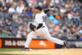 Alfredo Aceves of the New York Yankees pitches against the Tampa Bay Rays during their game at Yankee Stadium on May 4 2014 in the Bronx borough of...