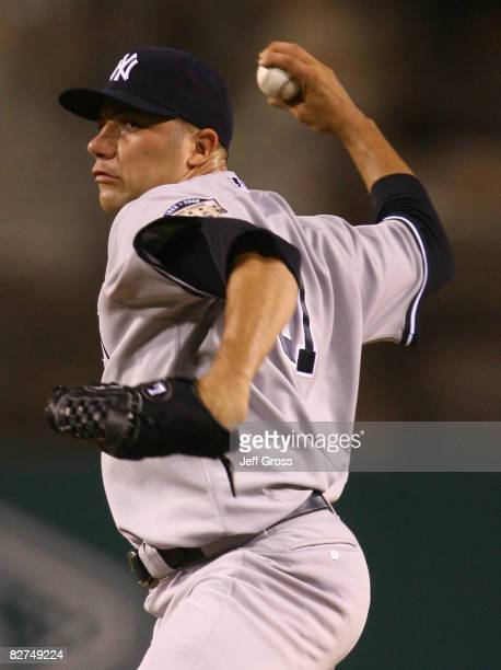 Alfredo Aceves of the New York Yankees throws a pitch in the first inning against the Los Angeles Angels of Anaheim at Angel Stadium on September 9...