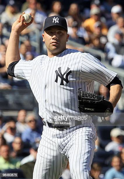 Alfredo Aceves of the New York Yankees throws to first base against the Los Angeles Angels of Anaheim on April 14 2010 at Yankee Stadium in the Bronx...