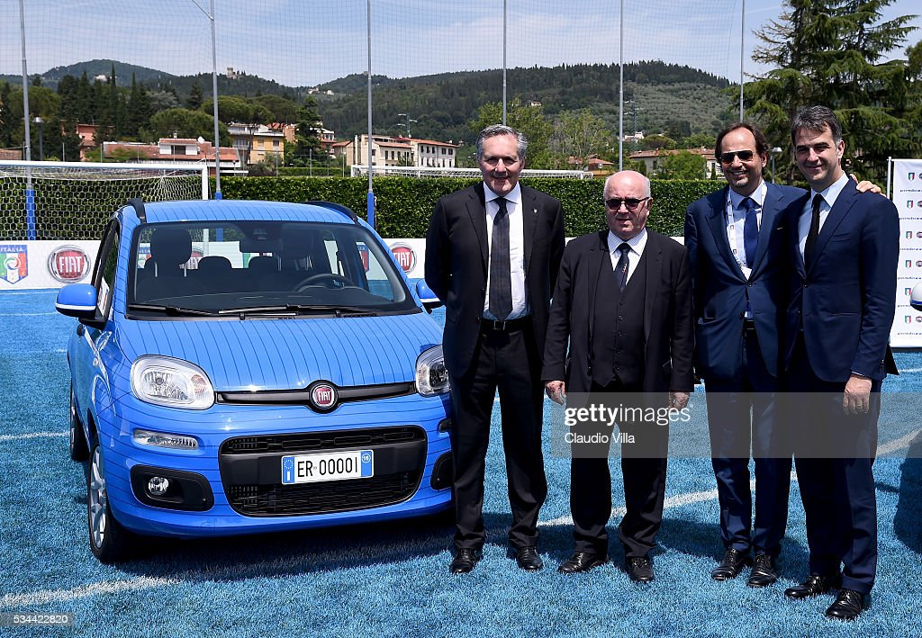 Alfredo Altavilla, President FIGC <a gi-track='captionPersonalityLinkClicked' href=/galleries/search?phrase=Carlo+Tavecchio&family=editorial&specificpeople=5365308 ng-click='$event.stopPropagation()'>Carlo Tavecchio</a>, Cristiano Fiorio and General Director FIGC Michele Uva attend Unveil New Panda Azzurri Car at Coverciano on May 26, 2016 in Florence, Italy.