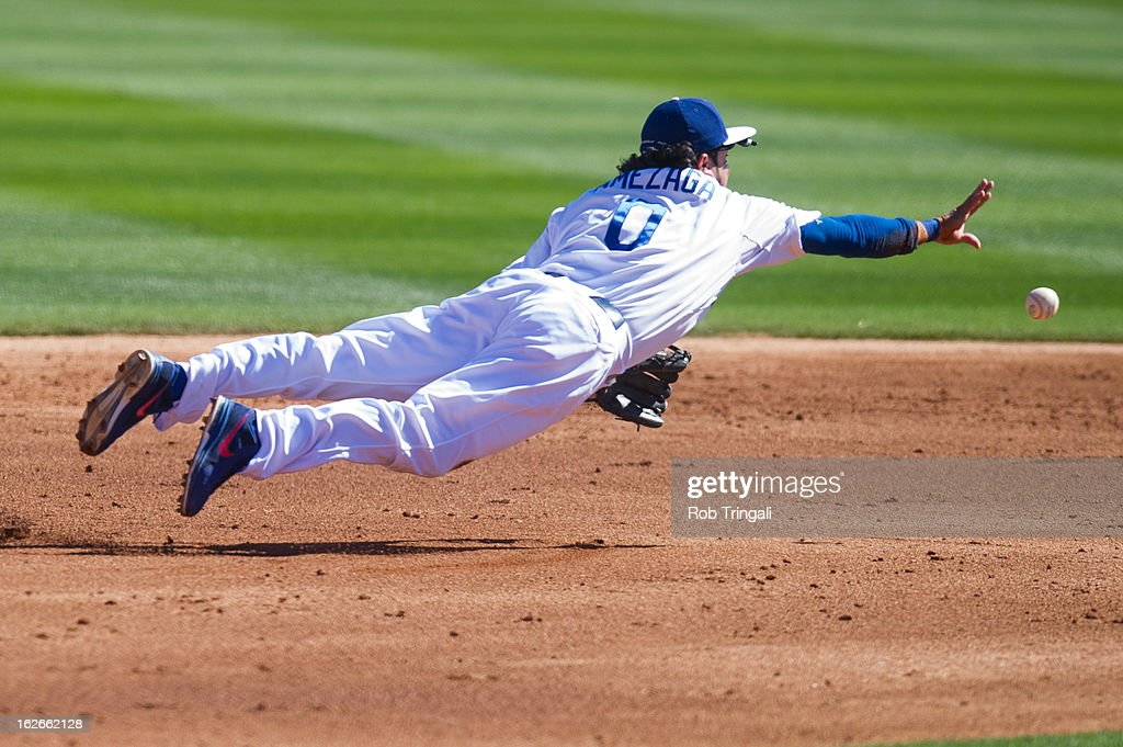 <a gi-track='captionPersonalityLinkClicked' href=/galleries/search?phrase=Alfredo+Amezaga&family=editorial&specificpeople=239472 ng-click='$event.stopPropagation()'>Alfredo Amezaga</a> #0 of the Los Angeles Dodgers leaps and tosses a ball in an attempt to get a force out at second base at Camelback Ranch on February 25, 2013 in Glendale, Arizona.