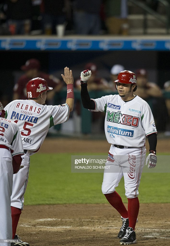 Alfredo Amezaga (R) of Yaquis de Obregon of Mexico celebrates his home run against Magallanes of Venezuela during the 2013 Caribbean baseball series on February 4, 2013 in Hermosillo, Sonora State, northern Mexico. AFP PHOTO/Ronaldo Schemidt