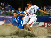 Alfredo Azuola of Costa Rica competes for the ball with Elmer Robles of El Salvador during day six of the CONCACAF Beach Soccer Championships El...