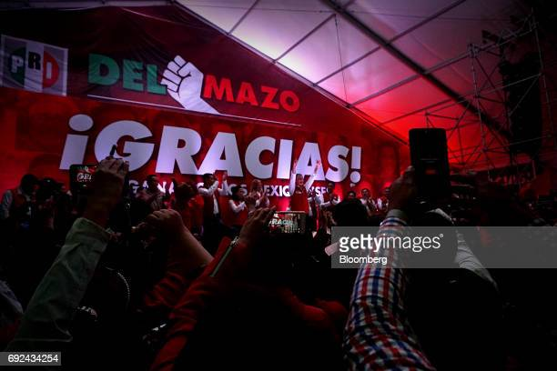 Alfredo del Mazo far center Institutional Revolutionary Party candidate for governor of the State of Mexico greets his supporters in Toluca Mexico...