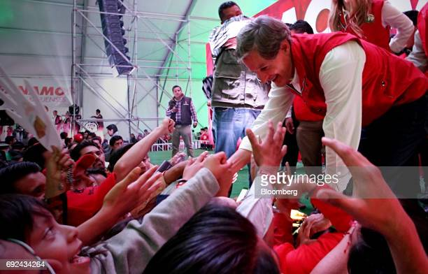 Alfredo del Mazo right Institutional Revolutionary Party candidate for governor of the State of Mexico greets his supporters in Toluca Mexico State...