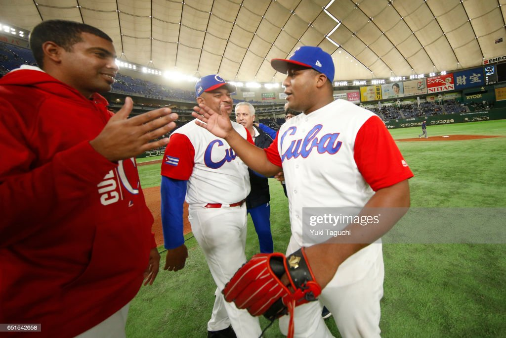 Alfredo Despaigne #54 of Team Cuba celebrates with teammates after after winning Game 5 of Pool B of the 2017 World Baseball Classic against Team Australia at the Tokyo Dome on Friday, March 10, 2017 in Tokyo, Japan.