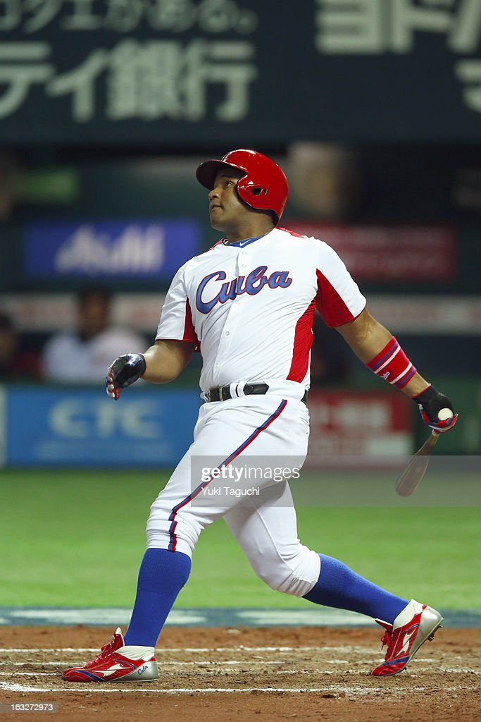 Alfredo Despaigne #54 of Team Cuba hits a three run home run in the bottom of the eighth inning during Pool A, Game 6 between Team Japan and Team Cuba during the first round of the 2013 World Baseball Classic at the Fukuoka Yahoo! Japan Dome on March 6, 2013 in Fukuoka, Japan.