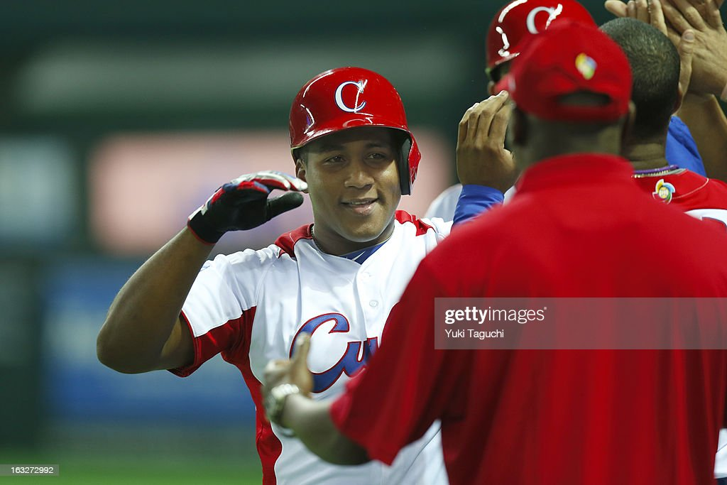 Alfredo Despaigne #54 of Team Cuba is greeted in the dugout after hitting a three run home run in the bottom of the eighth inning during Pool A, Game 6 between Team Japan and Team Cuba during the first round of the 2013 World Baseball Classic at the Fukuoka Yahoo! Japan Dome on March 6, 2013 in Fukuoka, Japan.