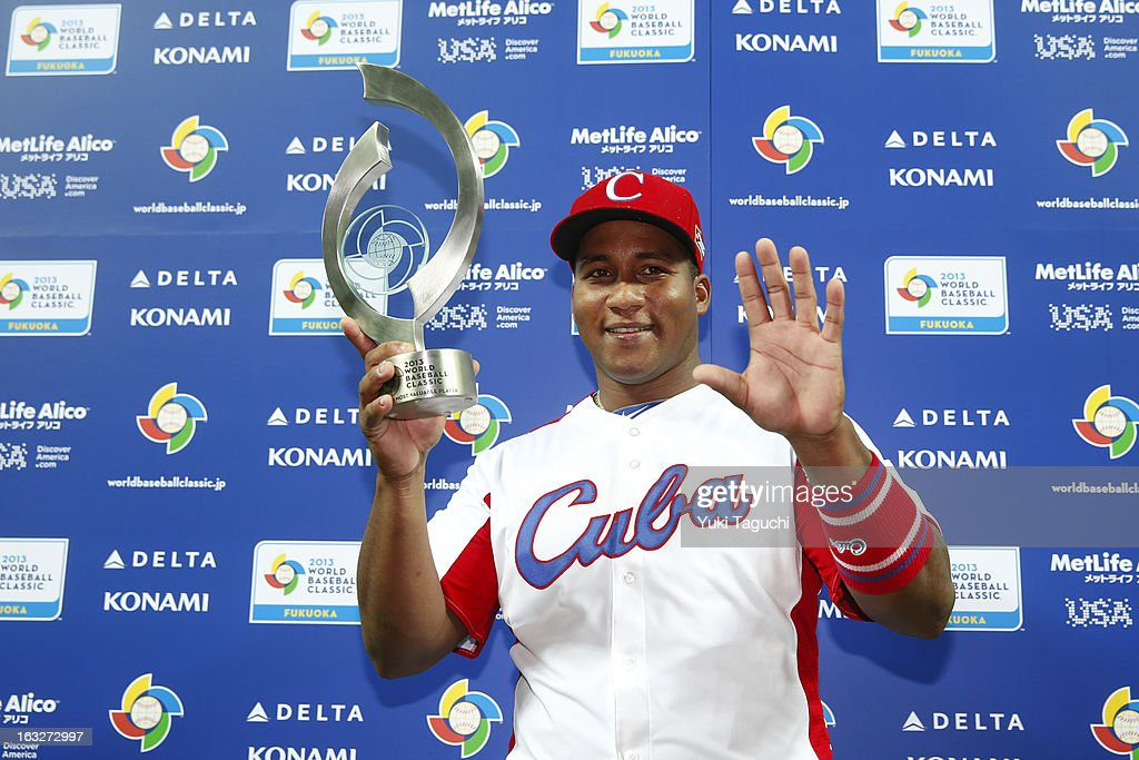 Alfredo Despaigne #54 of Team Cuba poses with he Pool A MVP trophy after the Pool A, Game 6 between Team Japan and Team Cuba during the first round of the 2013 World Baseball Classic at the Fukuoka Yahoo! Japan Dome on March 6, 2013 in Fukuoka, Japan.