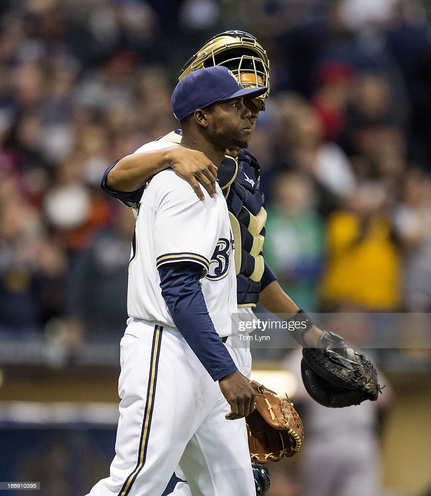 Alfredo Figaro #45 and Martin Maldonado #12 of the Milwaukee Brewers walk off the field after defeating the San Francisco Giants 7-2 at Miller Park on April 18, 2013 in Milwaukee, Wisconsin.