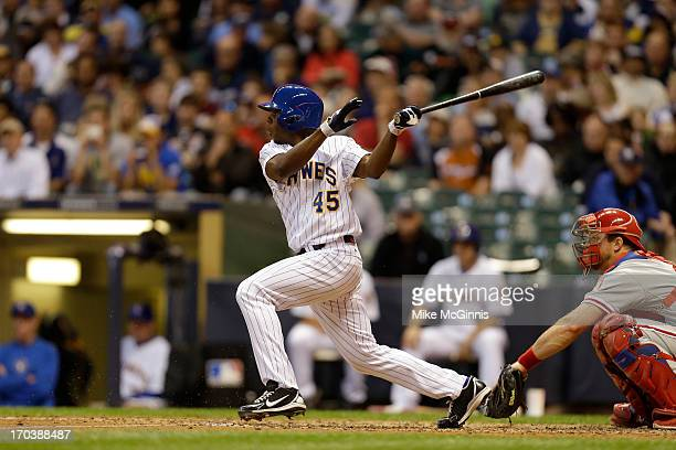 Alfredo Figaro of the Milwaukee Brewers singles during the game against the Philadelphia Phillies at Miller Park on June 07 2013 in Milwaukee...